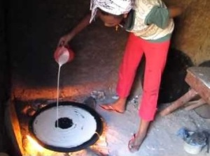 Making injera on a mitad in Ethiopia