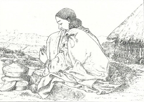 A 19th Century woman in the Samen Mountains prepares a meal  with a mesob (basket) beside her.