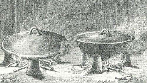Injera cooking in a mitad (left) and spicy wot cooking in a clay pot