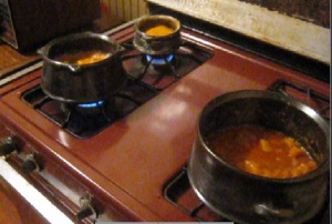 Cooking three dishes: duba wot (right),  doro tibs wot (left), shiro (background)