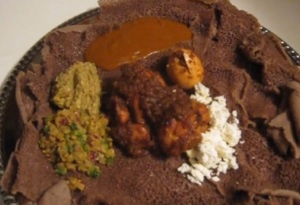 Doro wot served with azifa,  ayib and shiro on teff injera