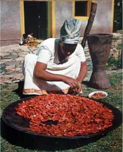 Drying peppers to make berbere