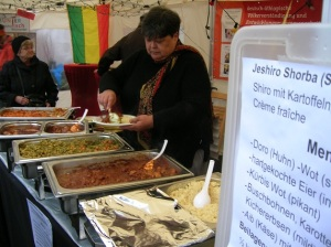 Stordiau serving her food at an event in Germany