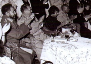 Emperor Haile Selassie and Yugoslavia's Marshal Tito  enjoy a western-style  meal together at a diplomatic event.