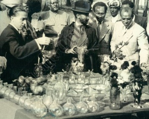 Emperor Haile Selassie tours an Ethiopian glass factory (1949). Notice the many bereles - flasks used for drinking t'ej.