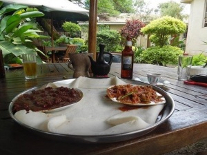 Siga wot and kitfo at Habesha in Kisumu, Kenya, a restaurant with a charming garden setting